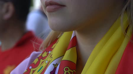 world cup : Sad lady in attributes of Spanish national football team standing still, loss