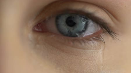 меланхолия : Crying woman eye close up, break up tears, problem sadness expression.