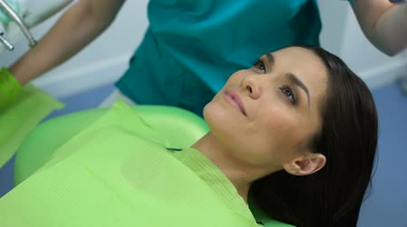 preventive : Beautiful woman on routine dental check-up, healthy teeth, happy patient Stock Footage