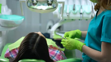rendes : Professional dental services, attentive qualified doctor examining patient teeth Stock mozgókép
