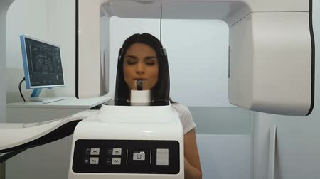 computed : Woman undergoing panoramic x-ray exam, professional radiographic equipment