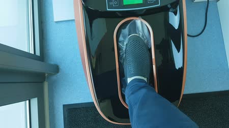 polyethylene : Automatic shoe cover dispenser in operation, sterility, hygiene in hospital Stock Footage