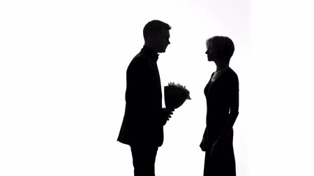 atmak : Angry wife tossing away husband bouquet, feeling hurt, relationship crisis