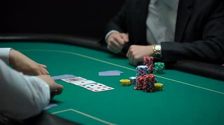 сочетание : Rich businessman making big bets, playing poker at illegal casino, addiction Стоковые видеозаписи