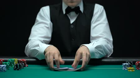 as : Casino dealer making shuffling tricks with cards, getting ace, lucky poker game Wideo