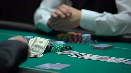 irresponsible : Confident businessman playing poker betting all property in risky game, gambling