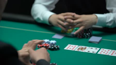 şanslı : Confident gambler making bet on losing combination, going all-in, addiction Stok Video