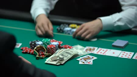 unlucky : Sad casino player losing poker game, professional croupier taking all chips