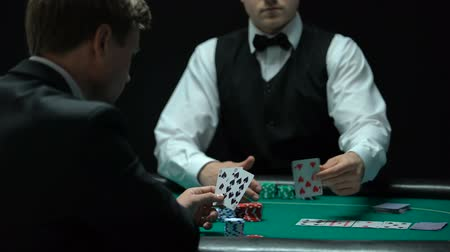 сочетание : Self-confident poker player making big bets at casino, chance to win, gambling Стоковые видеозаписи