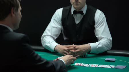 obsession : Casino player going all-in, betting all money and property keys, gambling man