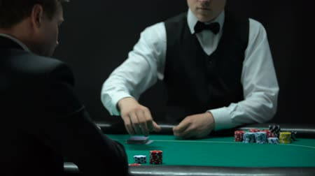 croupier : Upset man having bad combination in poker, throwing cards on table, weak hand