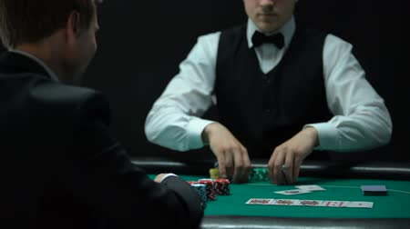 сочетание : Lucky poker player throwing one pair of aces on table, good combination, winner Стоковые видеозаписи