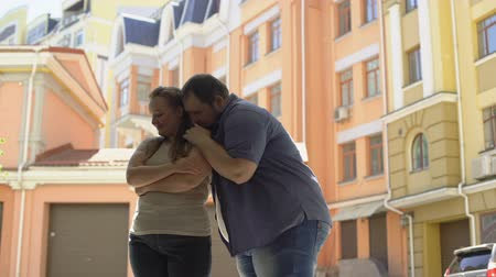 понимание : Obese male hugging shy girlfriend, trustful relationship in couple, insecurities