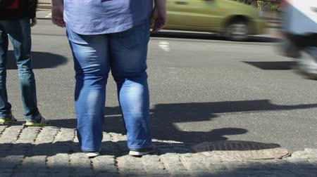 sedentary : Fat male standing city street, sedentary lifestyle effect, unhealthy nutrition