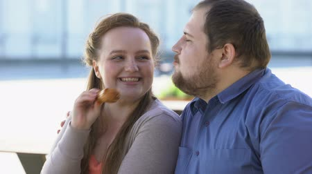 unconditional : Flirting girlfriend feeding fat boyfriend with fried chicken, obesity problem