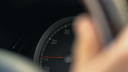kilometer : Person driving car, turning steering wheel, view on speedometer