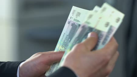 rentável : Business person counting Russian rubles in bank, putting money on deposit