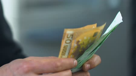 rentável : Man counting euros close-up, receiving social allowance money in bank, business