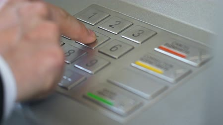 bankomat : Businessman hand inserting personal code and pressing enter button on ATM Wideo