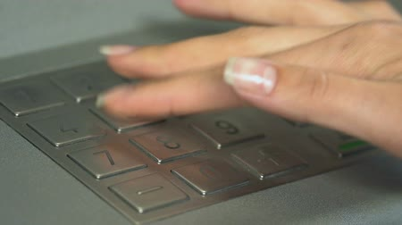 card pin : Female hand inserting pin code to check balance on bank account, ATM, banking Stock Footage