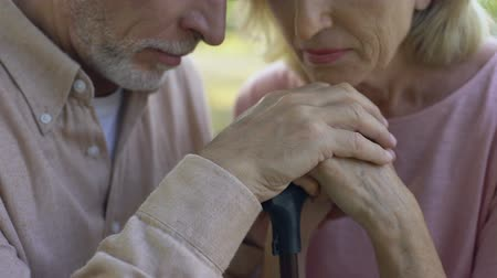 política : Elderly people lean on walking stick, concept of support, strong marriage, love