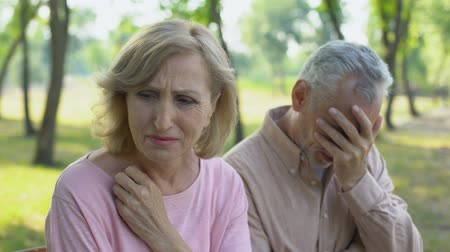 incurable : Elderly couple crying, frustrated with illness of close relative. Stock Footage