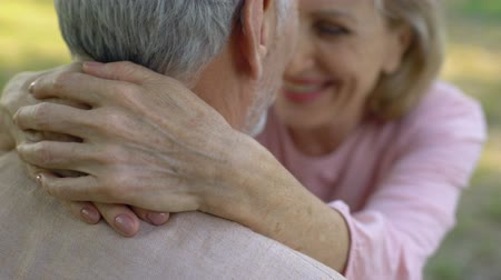 health insurance : Happy old couple embracing, comfortable retirement, secure old age