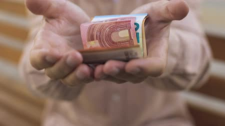 allowance : Old male hands showing money, retirement income, pension fund, insurance payment