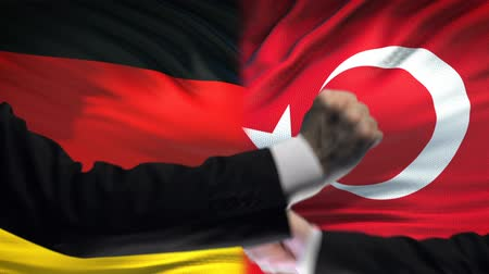 colision : Germany vs Turkey confrontation countries disagreement, fists on flag background