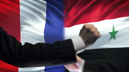 confronto : France vs Syria confrontation, countries disagreement, fists on flag background