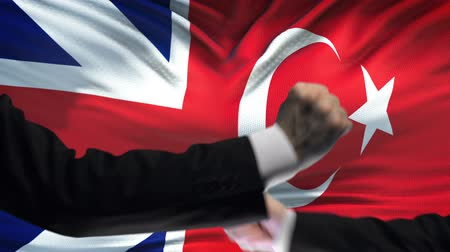 colision : Great Britain vs Turkey confrontation, fists on flag background, diplomacy