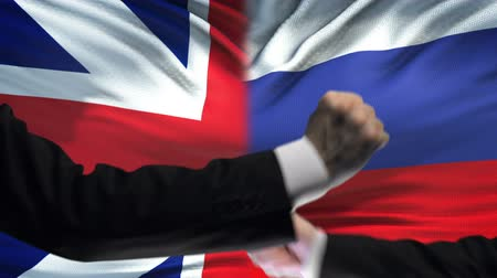 oposição : Great Britain vs Russia confrontation, fists on flag background, diplomacy Vídeos