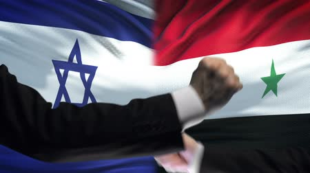 confronto : Israel vs Syria confrontation, countries disagreement, fists on flag background