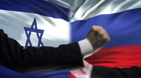 diffidenza : Israel vs Russia confrontation, countries disagreement, fists on flag background