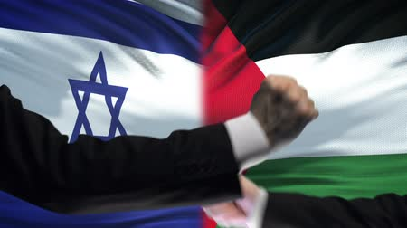 confronto : Israel vs Palestine confrontation, religious conflict, fists on flag background