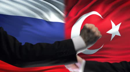 oposição : Russia vs Turkey confrontation, countries disagreement, fists on flag background