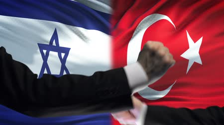 confronto : Israel vs Turkey confrontation, countries disagreement, fists on flag background