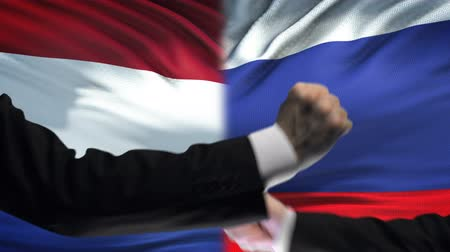 oposição : Netherlands vs Russia confrontation interests conflict, fists on flag background