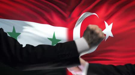 экономический : Syria vs Turkey confrontation, countries disagreement, fists on flag background