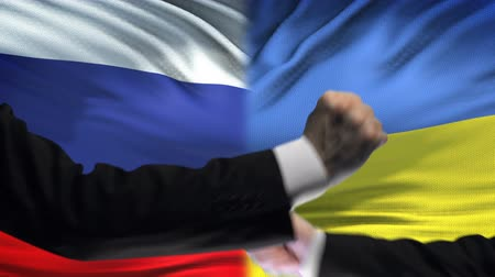 confronto : Russia vs Ukraine confrontation, interests conflict, fists on flag background
