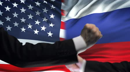 diffidenza : US vs Russia confrontation, countries disagreement, fists on flag background