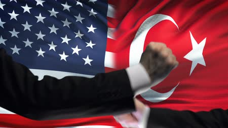 oposição : US vs Turkey confrontation, countries disagreement, fists on flag background