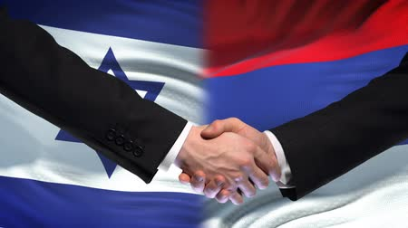 ministros : Israel and Russia handshake, international friendship relations, flag background