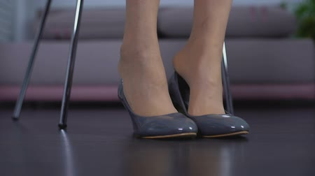 womanhood : Woman trying on pair of new comfortable shoes in boutique, shop customer, style Stock Footage