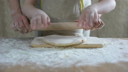 panelas : Little girl helping grandmother to roll dough for pizza, family recipe, cooking Stock Footage