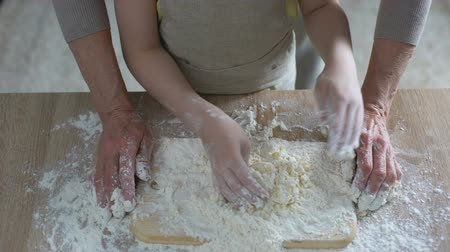 panelas : Little girl hands helping her grandmother to knead dough, traditional recipe