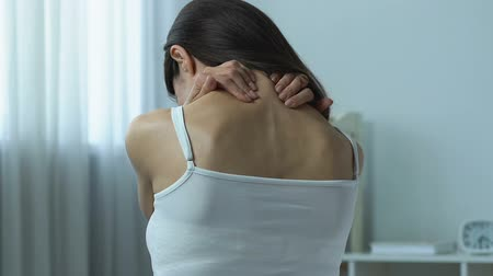 sedentary : Female massaging neck, lack of physical activity, sedentary lifestyle.