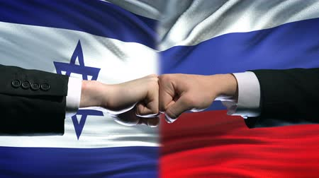 disputa : Israel vs Russia conflict, international relations, fists on flag background