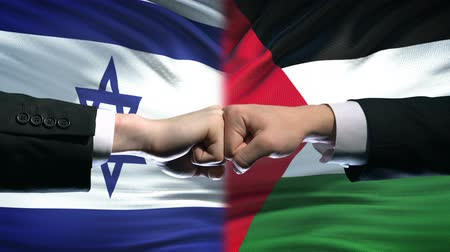 palestina : Israel vs Palestine conflict, international relations, fists on flag background Stock Footage