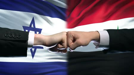 diffidenza : Israel vs Syria conflict, international relations, fists on flag background Filmati Stock